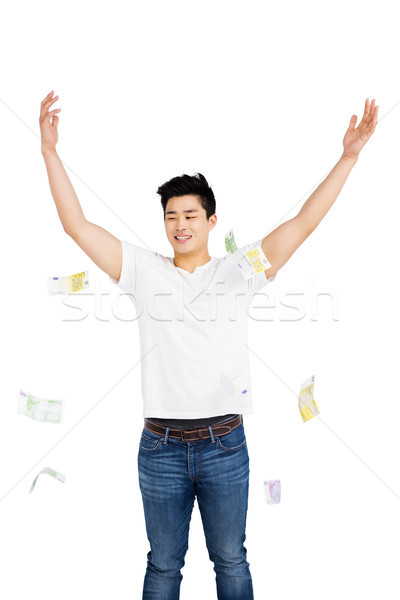 Happy young man throwing currency note Stock photo © wavebreak_media