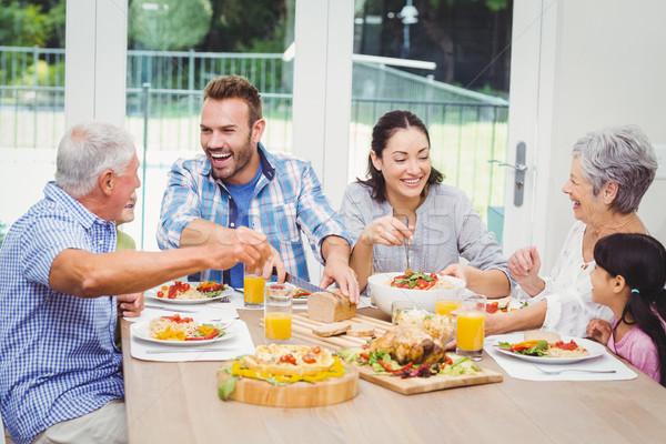 Happy multi generation family having food at dining table  Stock photo © wavebreak_media