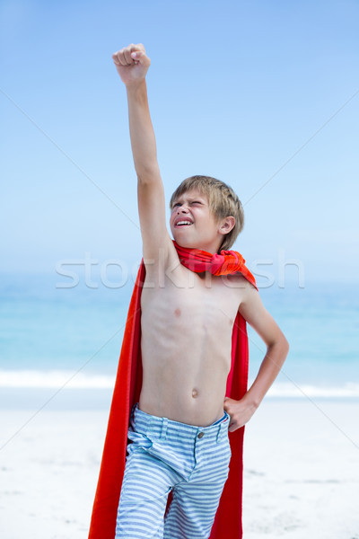 Boy in superhero costume with hand raised Stock photo © wavebreak_media