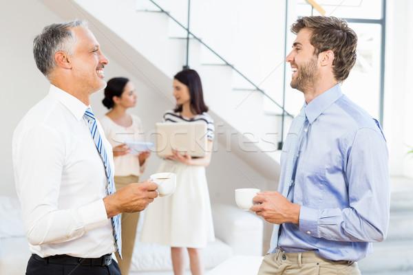 Businessmen interacting during a break time Stock photo © wavebreak_media
