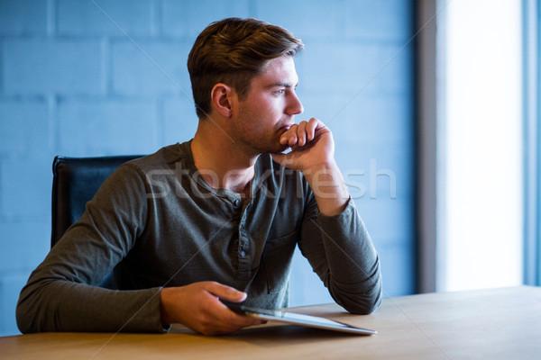 Thoughful businessman in office Stock photo © wavebreak_media