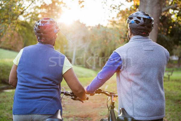Senior couple walking next to their bike Stock photo © wavebreak_media