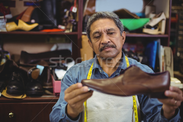 Shoemaker examining a shoe Stock photo © wavebreak_media