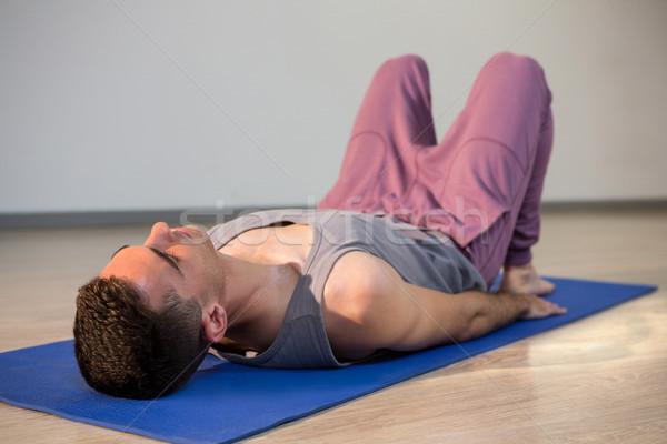 Férfi jóga holttest póz tornaterem fitnessz Stock fotó © wavebreak_media