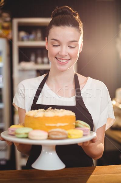 Waitress holding dessert on cake stand in cafe Stock photo © wavebreak_media