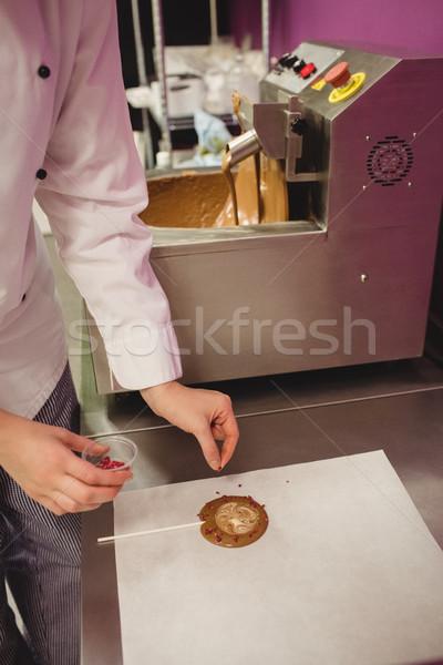 Travailleur lollipop cire papier cuisine femme Photo stock © wavebreak_media