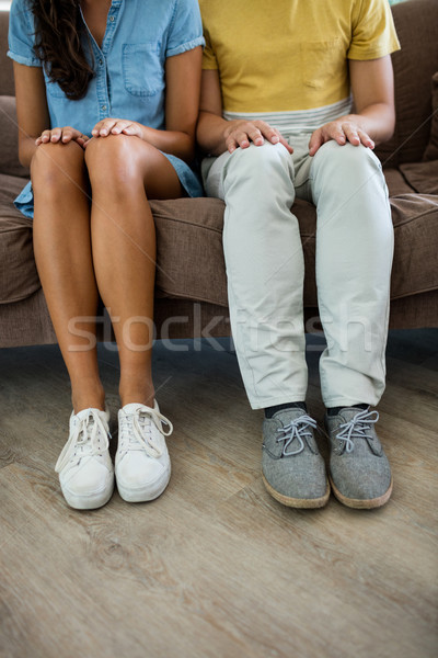 Couple sitting with hands on thighs in the living room Stock photo © wavebreak_media
