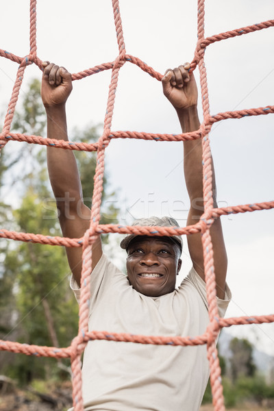 Military soldier climbing a net during obstacle course Stock photo © wavebreak_media