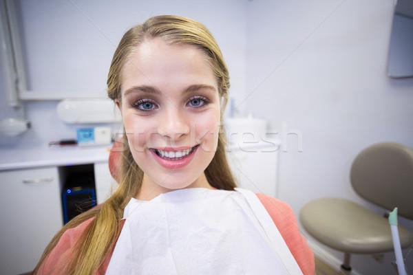 Souriant Homme patient séance dentistes président Photo stock © wavebreak_media