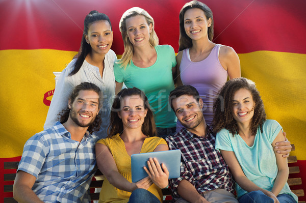 Composite image of smiling friends in the park using tablet pc Stock photo © wavebreak_media