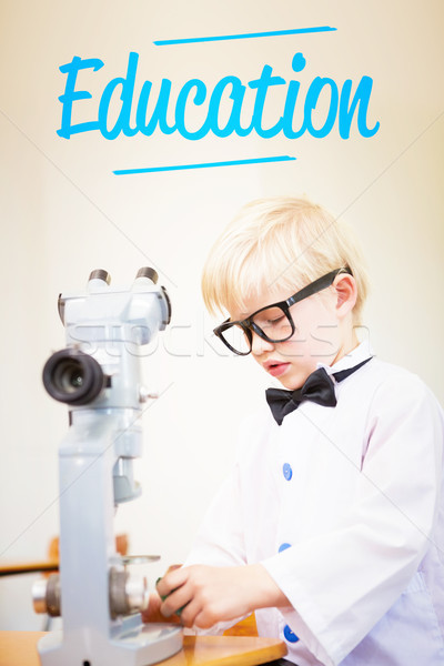 Education against cute pupil dressed up as scientist in classroo Stock photo © wavebreak_media