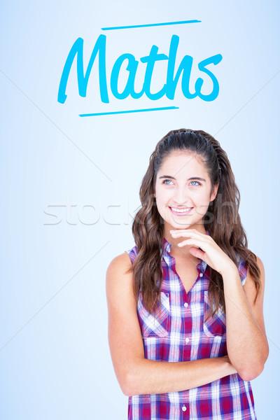 Maths against blue vignette background Stock photo © wavebreak_media