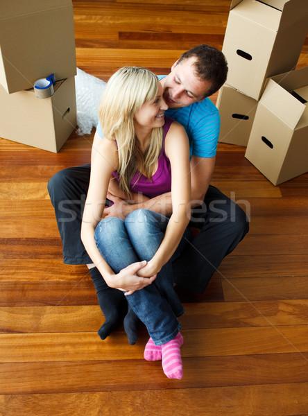Happy young couple sitting on floor. Moving house Stock photo © wavebreak_media