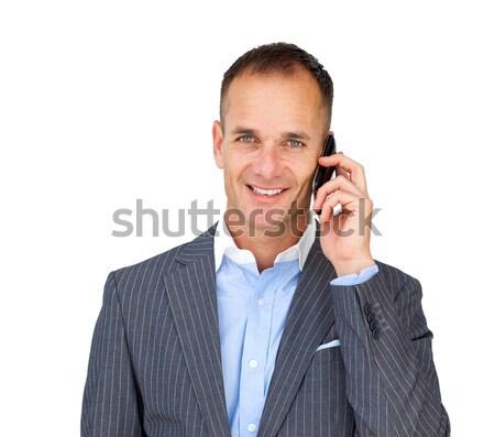 Assertive businessman using a mobile phone  Stock photo © wavebreak_media