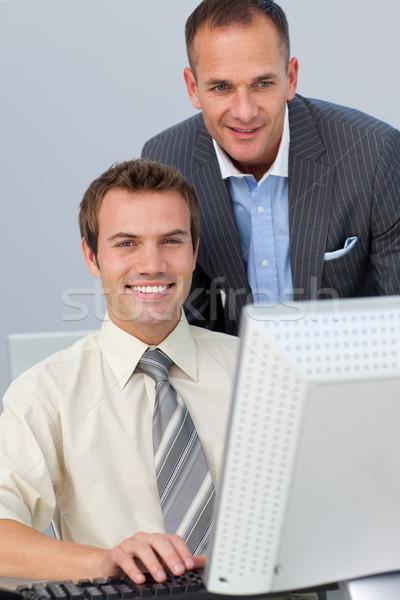 Vonzó menedzser alkalmazottak munka iroda férfi Stock fotó © wavebreak_media