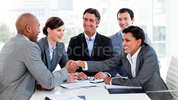Glücklich Geschäftsleute Schließen viel Sitzung Hand Stock foto © wavebreak_media