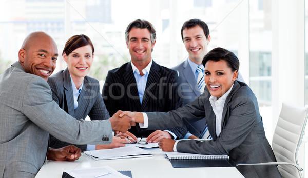A diverse business group closing a deal Stock photo © wavebreak_media
