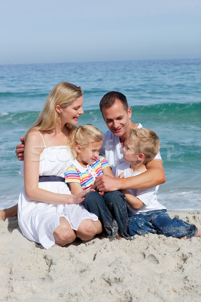 Portrait of an affectionate family sitting on the sand  Stock photo © wavebreak_media