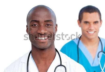Charming doctors smiling at the camera  Stock photo © wavebreak_media