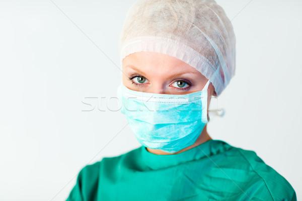 Mujer atractiva cirujano máscara cara médico feliz Foto stock © wavebreak_media