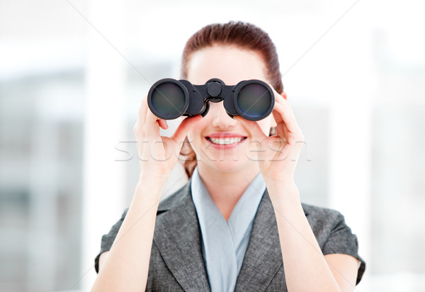Attractive businesswoman using binoculars  Stock photo © wavebreak_media
