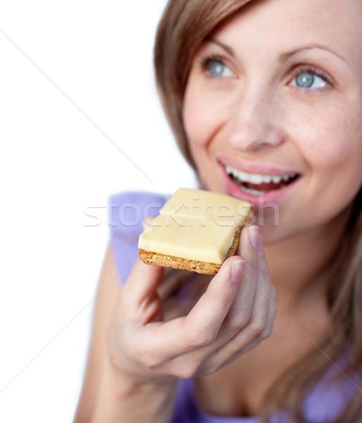 Mulher alimentação queijo isolado branco comida Foto stock © wavebreak_media