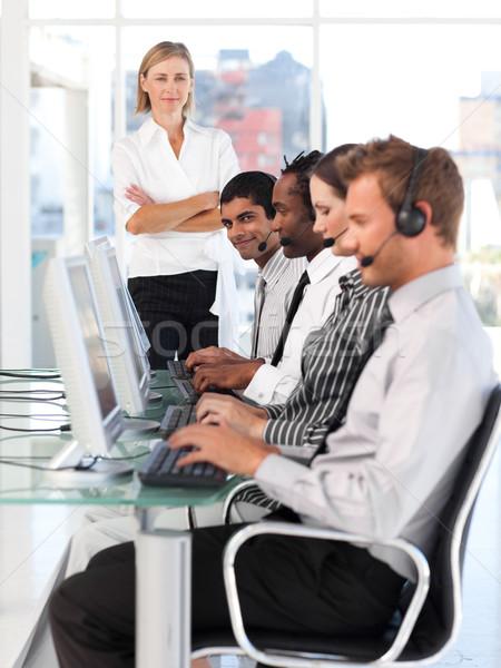 Assertive manager leading her representative team in a office Stock photo © wavebreak_media