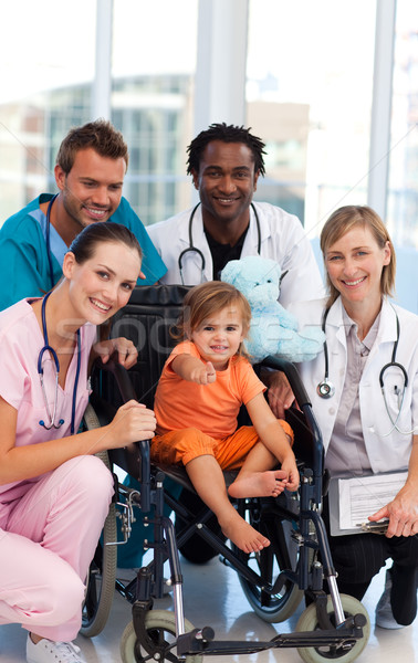 Baby girl in a wheelchair with medical team Stock photo © wavebreak_media