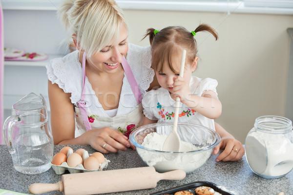 Mother and daughter baking cookies in kitchen Stock photo © wavebreak_media