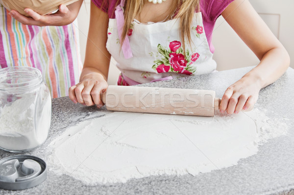 Stock photo: Close-up of two caucasian woman baking in the kitchen at home