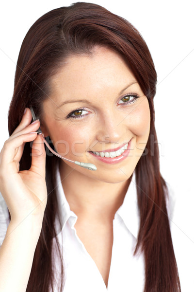 Smiling young businesswoman wearing headphones against a white background Stock photo © wavebreak_media