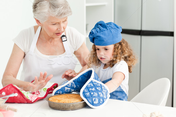 A little girl  baking with her grandmother Stock photo © wavebreak_media