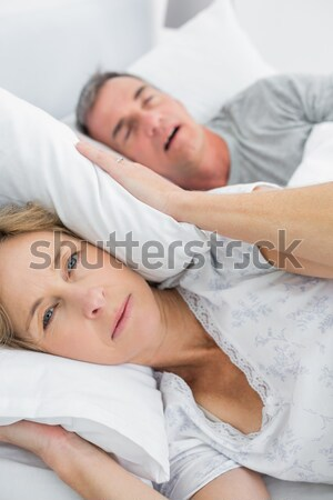 Lovely couple lying down in their bed Stock photo © wavebreak_media