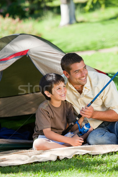 Son fishing with his father Stock photo © wavebreak_media