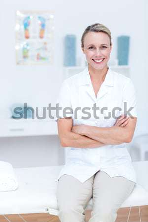 Dark-haired woman with safety glasses posing in a lab Stock photo © wavebreak_media