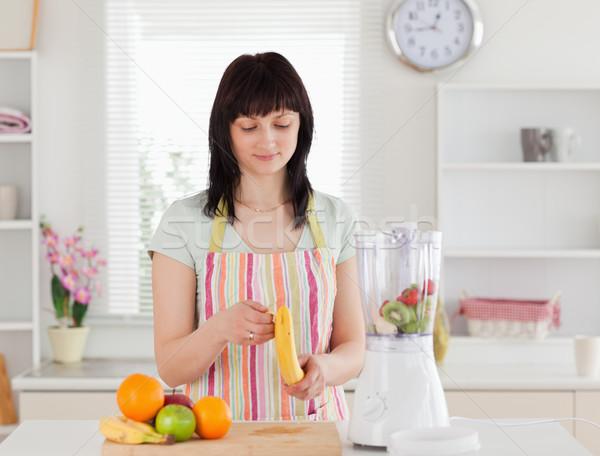 красивый брюнетка женщину банан Постоянный кухне Сток-фото © wavebreak_media
