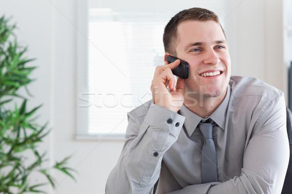 Sorridente empresário agradável chamar telefone móvel negócio Foto stock © wavebreak_media