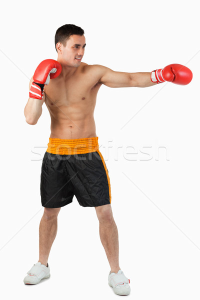 Side view of boxer hitting straight against a white background Stock photo © wavebreak_media