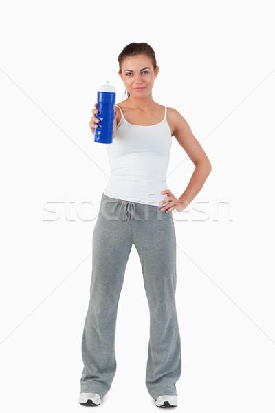 Mulher oferta sorvo água branco Foto stock © wavebreak_media