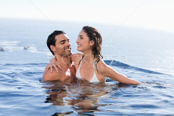 Couple playing together in a swimming pool Stock photo © wavebreak_media