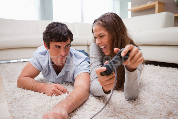 Young woman just defeated her boyfriend at a video game Stock photo © wavebreak_media