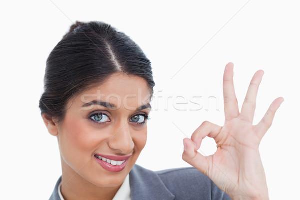 Sorridente feminino aprovação branco Foto stock © wavebreak_media