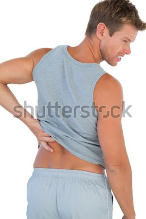 Blonde woman showing pain in her back and in her neck against a white background Stock photo © wavebreak_media