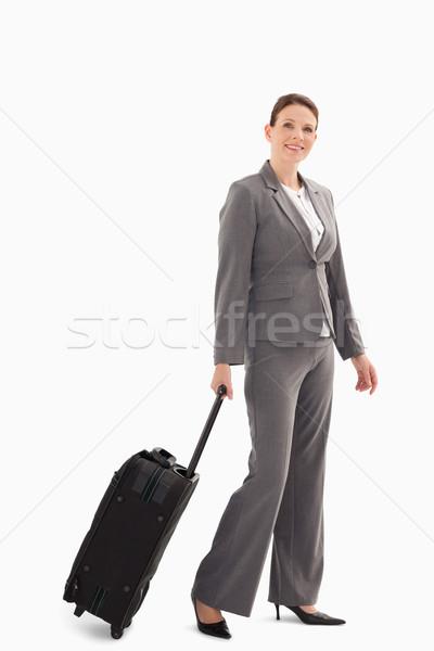 деловая женщина ходьбе чемодан бизнеса моде фон Сток-фото © wavebreak_media