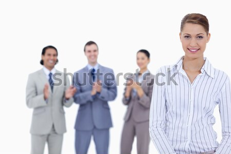 Close-up of a woman smiling with business people applauding in background Stock photo © wavebreak_media