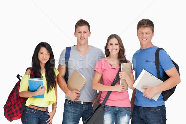 Grupo sorridente estudantes veja câmera Foto stock © wavebreak_media
