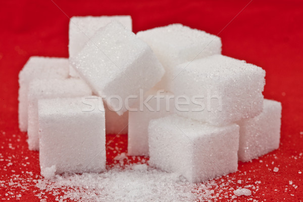 Stack of sugar  against a red background Stock photo © wavebreak_media