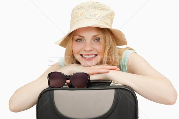 женщину чемодан улыбаясь белый счастливым Сток-фото © wavebreak_media