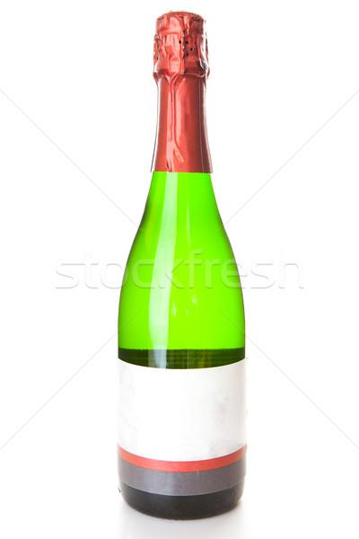 Bubbly bottle against a white background Stock photo © wavebreak_media