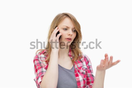 Woman calling against a white background Stock photo © wavebreak_media